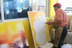 Los pintores del Cibao y la Frontera hicieron un performance todo el tiempo que duró la Asamblea.